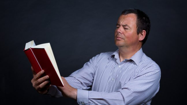 Man finding it increasingly difficult to read without glasses